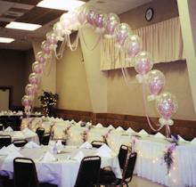 Head table decorated with balloons